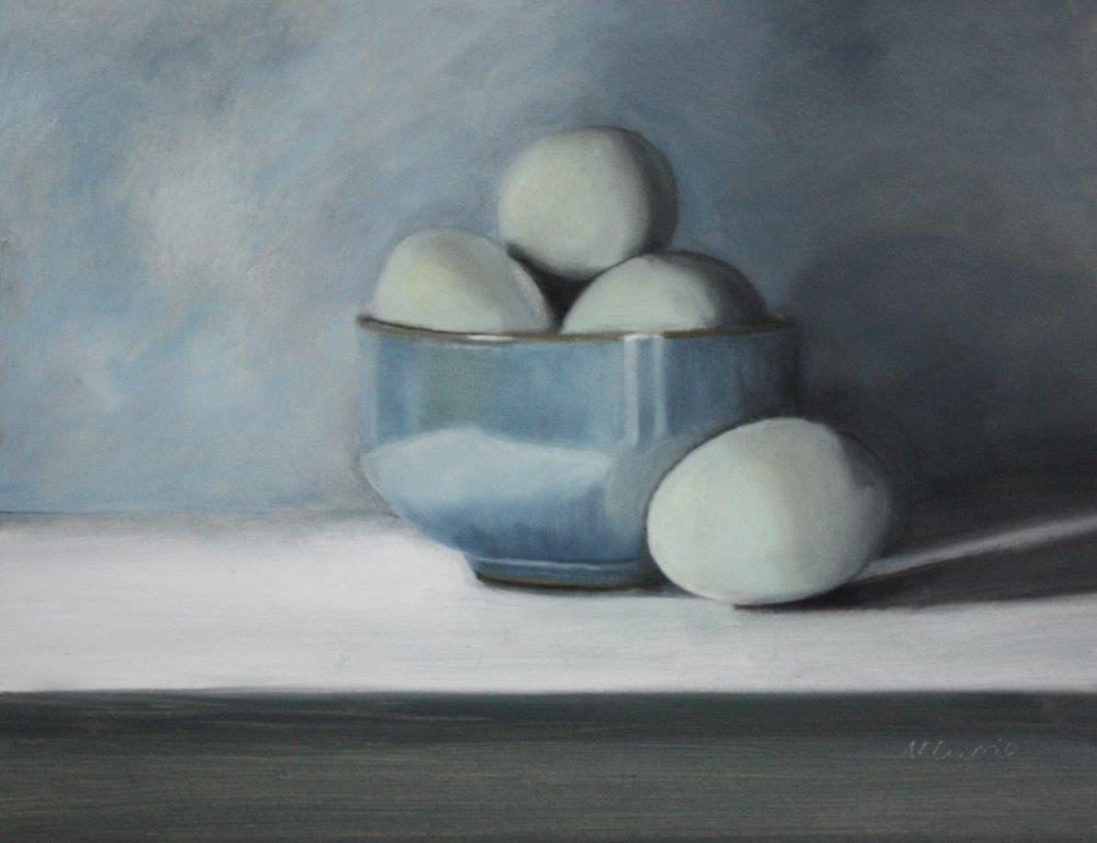 Blue Sussex hen eggs in ceramic bowl